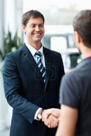 Photo for Buyer and seller shake hands - Royalty Free Image