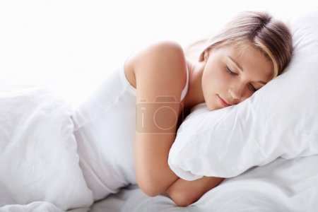 Photo for Young girl sleeping in bed - Royalty Free Image