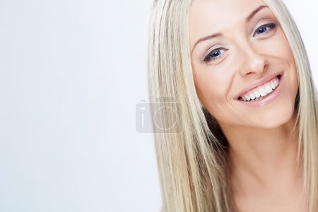 Photo for Smiling young girl on a white background - Royalty Free Image