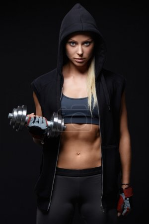 Photo for Athletic girl in a hood with dumbbell - Royalty Free Image