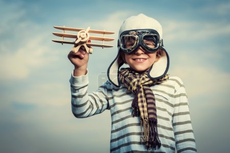 Photo for Happy boy with wooden plane - Royalty Free Image