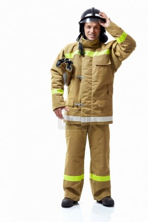 Photo for Fireman in uniform on a white background - Royalty Free Image