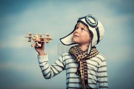 Photo for Boy with a plane on sky background - Royalty Free Image