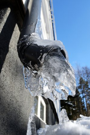 close-up of frozen drainpipe