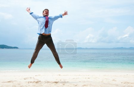 Photo for Funny business man jumping on the beach - Royalty Free Image