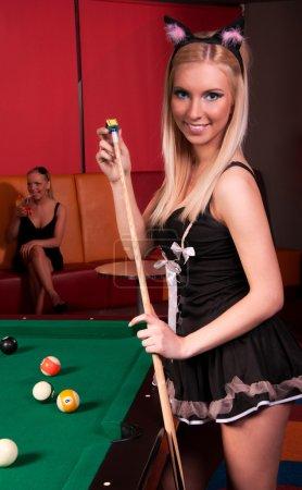 Happy girls playing in billiard
