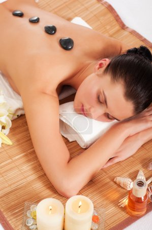 Attractive woman getting spa treatment isolated on white backgro