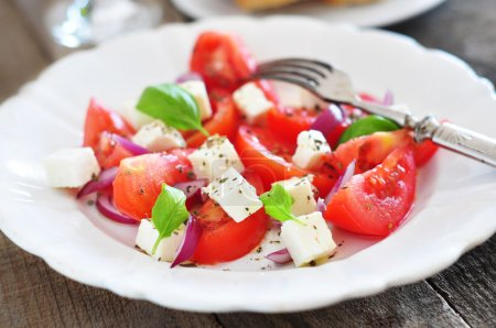 Photo for Salad with tomatoes, pepper and feta cheese - Royalty Free Image