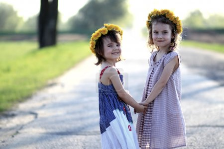 Two girls with garlands