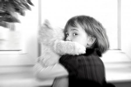 Frightened little girl hugging teddy bear