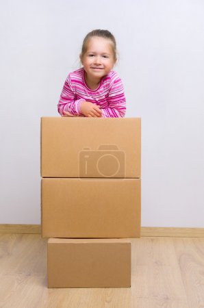 Photo for Little smiling girl with boxes - Royalty Free Image