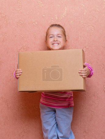 Photo for Little smiling girl with box - Royalty Free Image