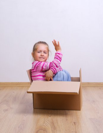 Photo for Little curious girl in a box - Royalty Free Image