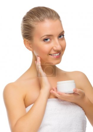 Young smiling girl with body cream