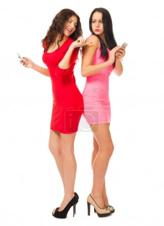 Photo for Two young girls with mobile phones isolated - Royalty Free Image