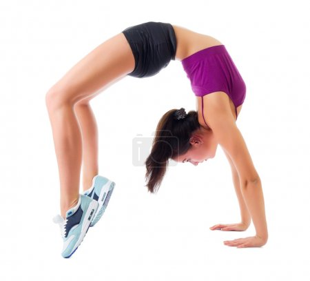 Photo for Sporty girl doing gymnastic exercises isolated - Royalty Free Image