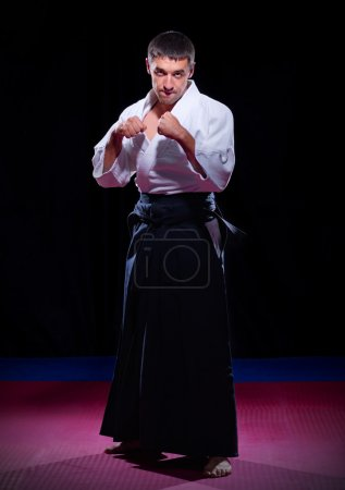 Photo for Aikido fighter on black background - Royalty Free Image