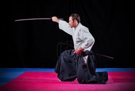 Photo for Martial arts fighter with katana on black - Royalty Free Image