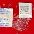 Macro of silica gel bags on red background...