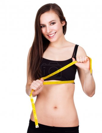 healthy pretty woman measuring her waist