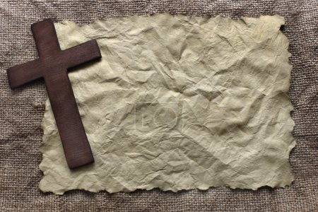 Photo for Wooden cross on old paper - Royalty Free Image