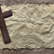 Wooden cross on old paper...