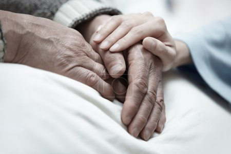 Photo for Hand of woman touching senior man in clinic - Royalty Free Image