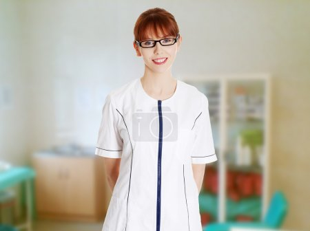 Young woman in healthcare worker uniform
