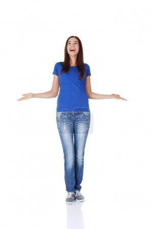 Surprised teen girl with outstretched arms.