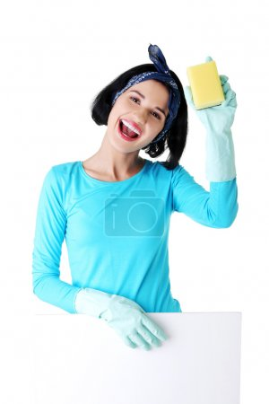 Cleaning woman showing blank sign board.