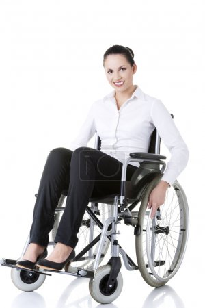 Photo pour Attractive smiling disabled businesswoman sitting in a wheel chair isolated on white - image libre de droit