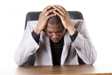 Photo for Sad, tired or depressed businessman at the desk. - Royalty Free Image