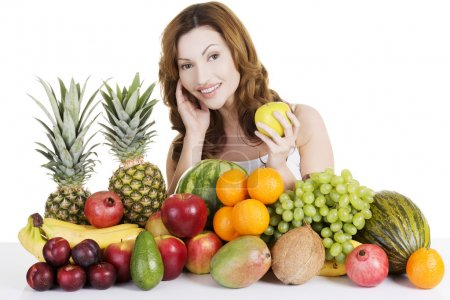 Beautiful woman with fruits