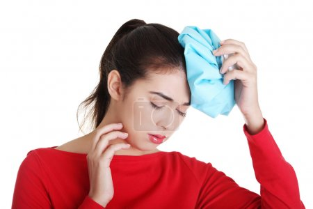 Photo for Woman with ice bag for headaches and migraines , isolated on white - Royalty Free Image