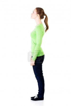 Attractive woman standing and looking up. Side view.