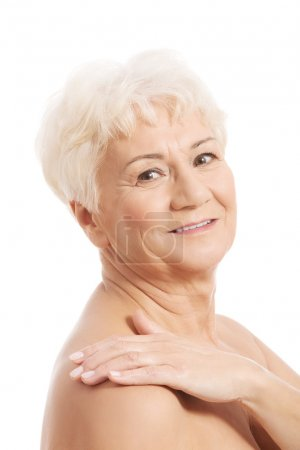 An old nude woman's head and shoulders.