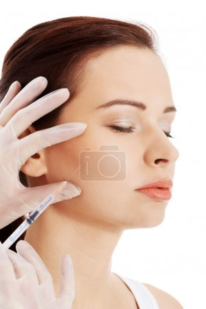 Beautiful woman's face is being prepareg to plastic surgery.