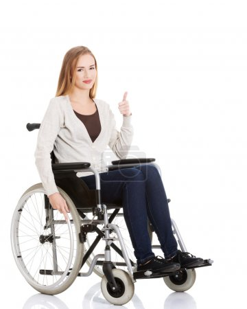 Beautiful caucasian woman sitting on a wheelchair.