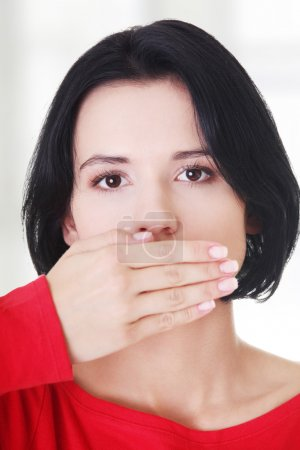 Teen woman covering mouth with hand