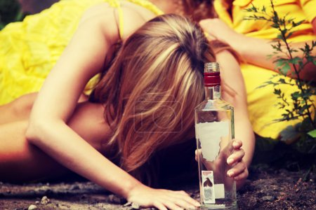 Photo for Teen alcohol addiction (drunk teens with vodka bottle - Royalty Free Image