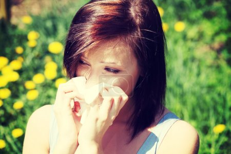 Girl with runny nose, having allergy