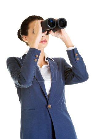 Businesswoman with binoculars.