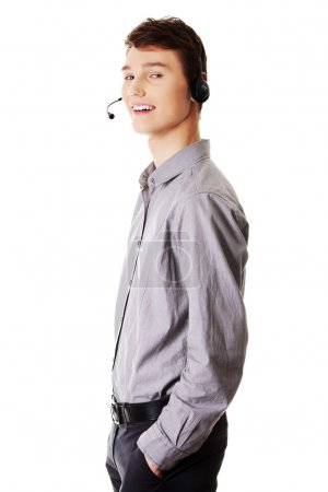Young handsome call center worker.