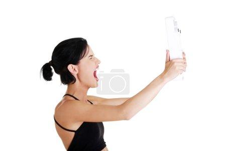 Photo pour Femme frustrée avec échelle, isolée sur blanc - image libre de droit