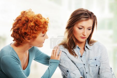 Photo for Troubled young girl comforted by her friend. - Royalty Free Image