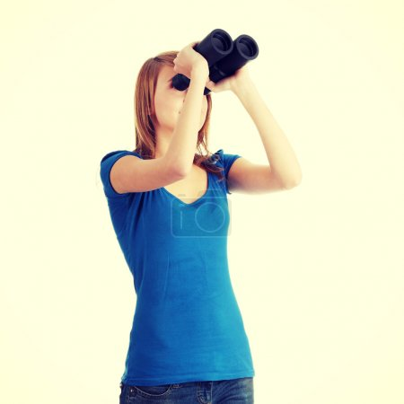 Photo for Teen girl with binocular - Royalty Free Image