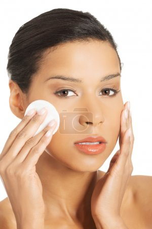 Woman with cosmetic pad.