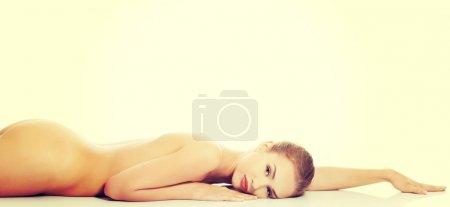 Naked woman lying down.