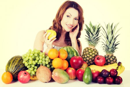 Photo for Beautiful woman with exotic fruits. - Royalty Free Image