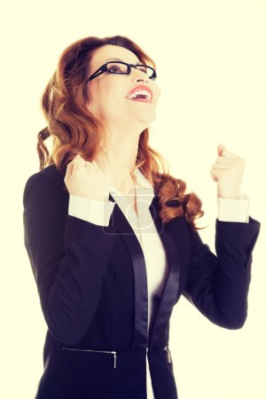 Photo for Winner businesswoman celebrating success with fists up - Royalty Free Image